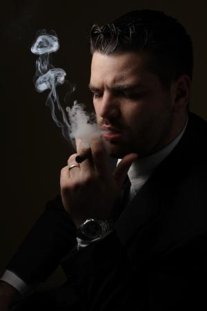 Low key portrait of adult smoker photo