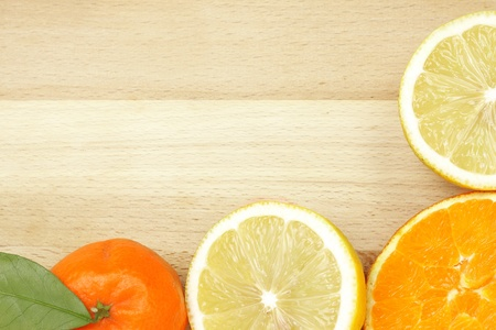 Citrus border on wooden table with copyspace photo