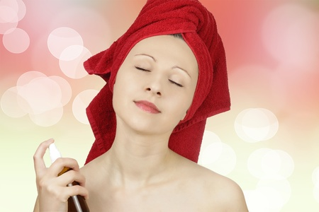 Young caucasian woman perfuming herself Stock Photo - 8918807