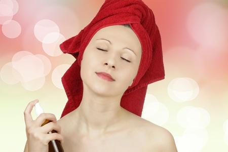 Young caucasian woman perfuming herself Stock Photo - 8918807