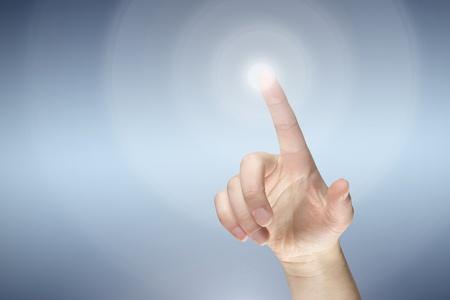 Female finger pressing virtual button