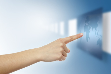 Pointer finger touching virtual world map Stock Photo