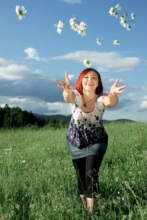 Woman throwing daisies Stock Photo - 9081663