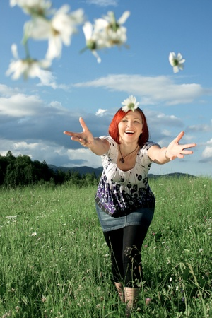 Woman throwing daisies photo