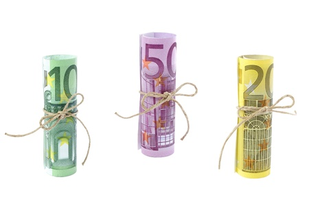 Rolled and tied Euro banknotes isolated on white photo