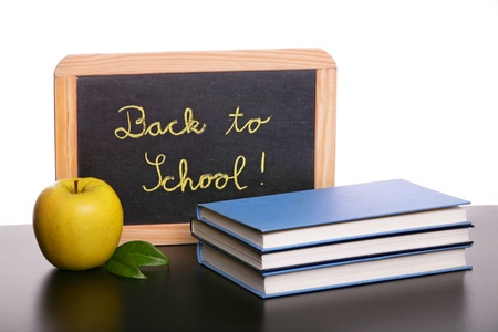 Chalkboard, apple  and  books, back to school concept photo
