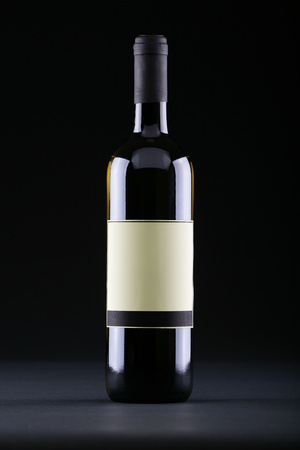 Studio shot of wine bottle with etiquette on black background