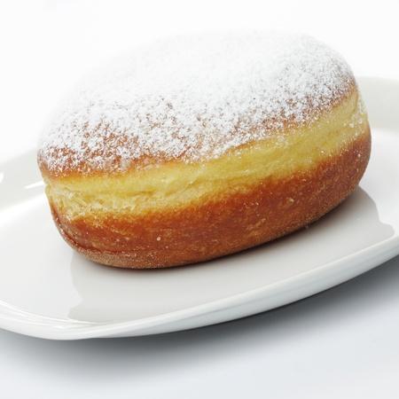 slovenian: Traditional slovenian doughnut on white plate