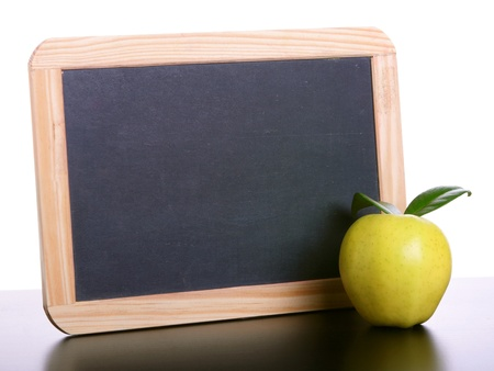 Apple and chalkboard with copy space photo