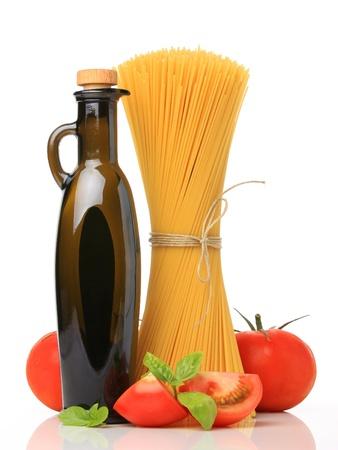 carbonates: Italian spaghetti, oil and tomatoes, isolated on white Stock Photo