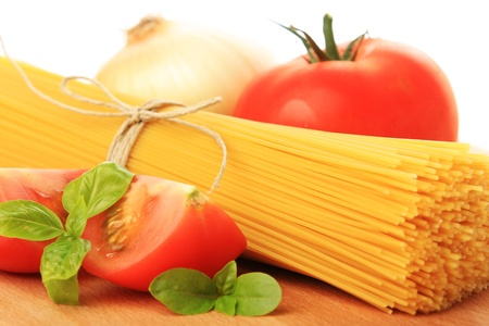 carbonates: Italian spaghetti and vegetables, isolated on white