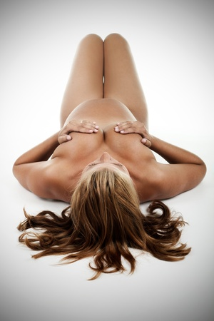 Beautiful pregnant woman lying on the floor, added vignette photo