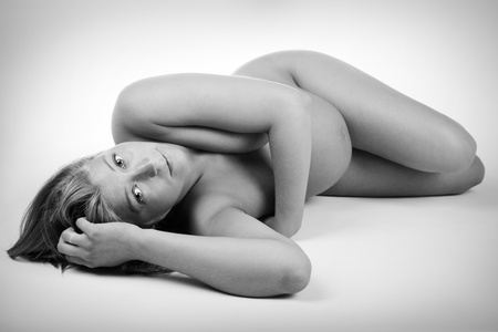 Beautiful pregnant woman lying on the floor, added vignette Stock Photo - 10126843