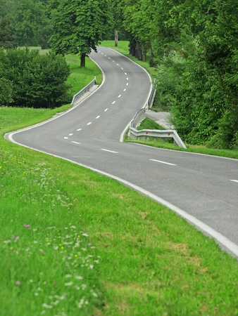 Asphalt winding curve road in nature photo