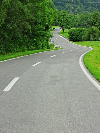twisty: Asphalt winding curve road in nature