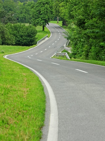 winding road: Asphalt winding curve road in nature