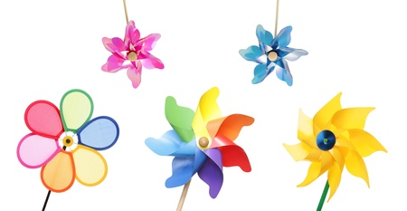 colorful pinwheel toys isolated on white photo