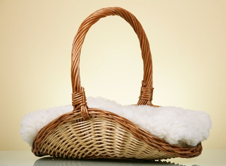 cepelia: Wicker basket with blanket against yellow background Stock Photo