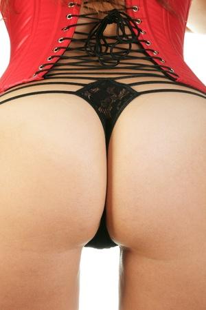 女性セクシーな赤のコルセットと黒皮ひも