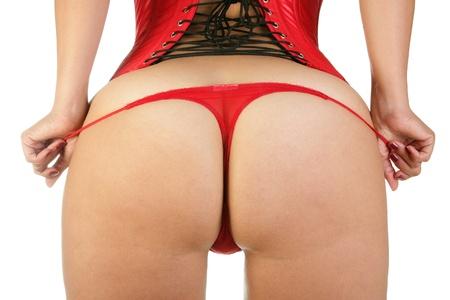 Nő a szexi piros fűző és vörös tanga Stock fotó