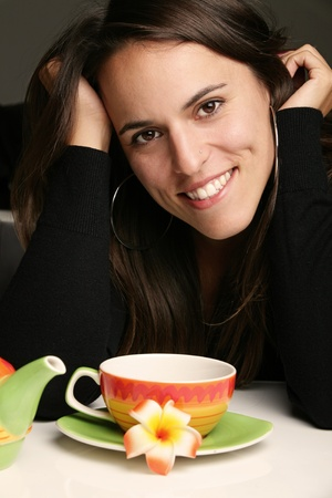 Woman relaxing with a cup of hot tea photo