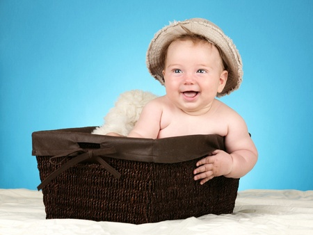 babycare: Adorable baby boy in wicker basket