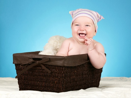 Adorable baby boy in wicker basket Stock Photo - 10254037