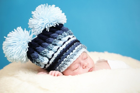 Adorable newborn with big knitted hat Stock Photo - 10415381