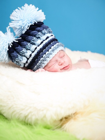 Adorable newborn with big knitted hat Stock Photo - 10415378