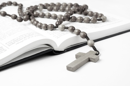 Open Bible with rosary beads  photo