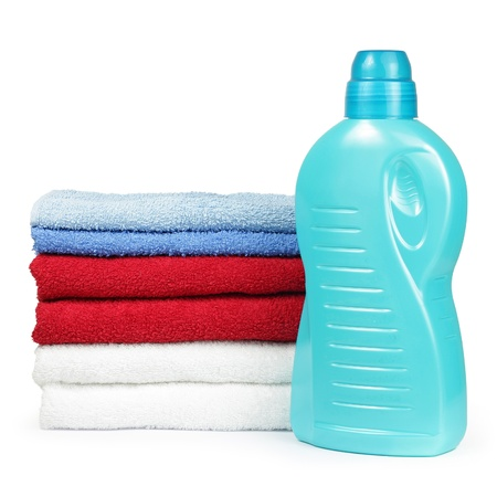 liquid material: Towels and liquid laundry detergent isolated on white background  Stock Photo
