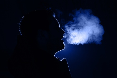 Colored outline of a man exhaling warm breath Stock Photo