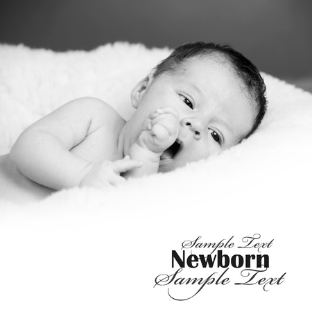Adorable newborn baby in black and white Stock Photo