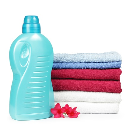 Towels and liquid laundry detergent with oleander flower Stock Photo