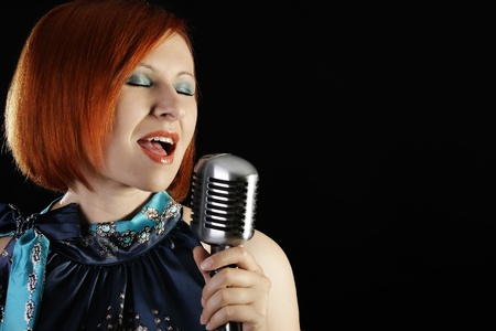 shure: Retro redhead female singer with microphone
