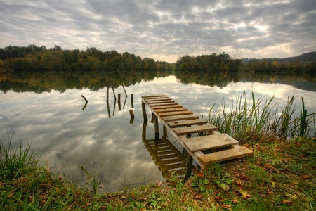 Beautiful lake with pier on cloudy day Stock Photo - 11118721