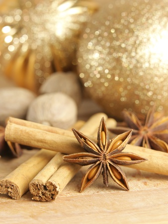 Christmas spices and baubles on wooden board Stock Photo