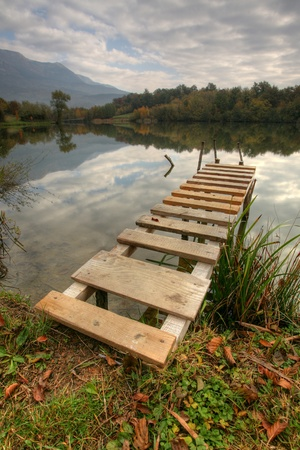 Beautiful lake with pier on cloudy day Stock Photo - 11194251