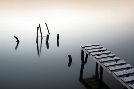 Small pier and wooden docks in the early morning Stock Photo - 11374430
