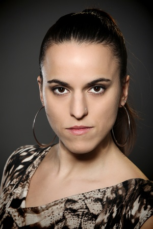 bijoux: Portrait of beautiful serious looking latina Stock Photo