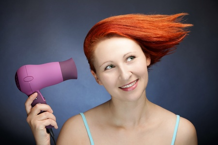 Cure redhead woman drying her hair photo