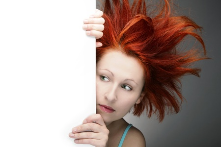 Redhead woman with messy hair with copy space photo