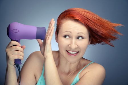 Cure redhead woman drying her hair Stock Photo - 11889959