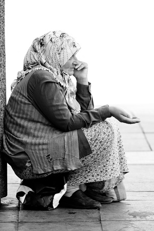 Sarajevo, Bosnia and Herzegovina - AUGUST 14 - An unidentified muslim woman begs on August 14, 2011 in in Sarajevo, capital  city of Bosnia and Herzegovina.