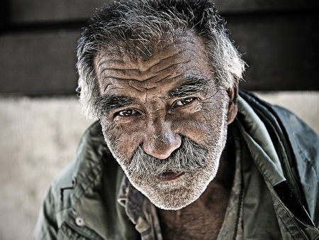Belgrade, Serbia - August 18: An unidentified homeless man in Skadarlija - part of Belgrade, Serbia on August 18, 2011. There are many homeless and poor people on the streets of capital city in Serbia. Serbia is struggeling with poverty.