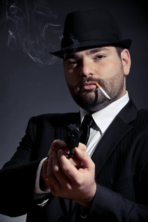 gangster with gun: Dangerous man in suit with a gun