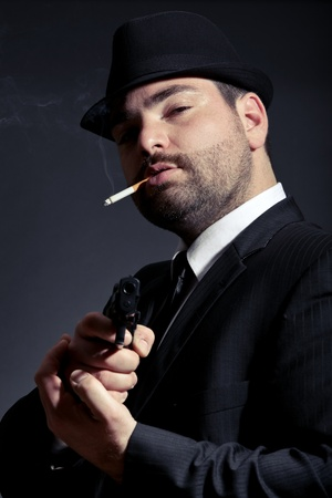 Dangerous man in suit with a gun photo