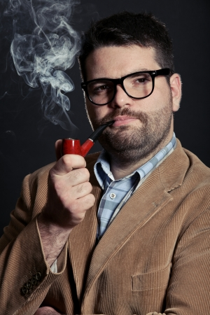 Man with pipe and glasses smoking photo