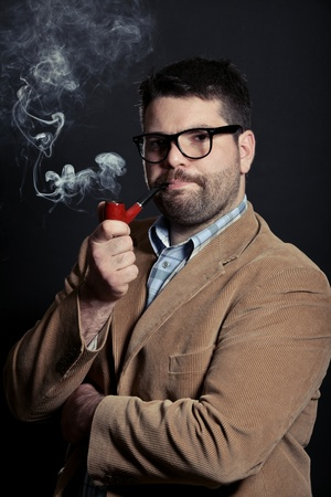professors: Man with pipe and glasses smoking Stock Photo