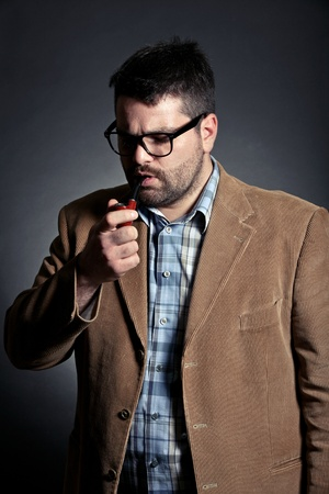 prof: Man with pipe and glasses smoking Stock Photo
